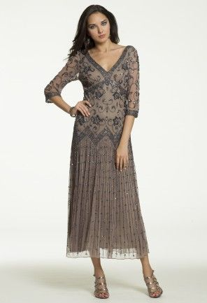 You'll be wishing for a fall wedding just so you can wear and show off this amazingly beautiful tea length dress!