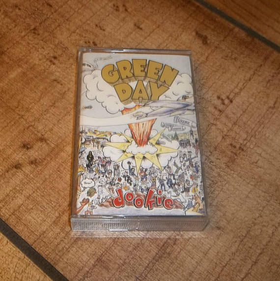 Dookie by Green Day on glorious audio cassette tape! Both the tape and case are in great condition.  TRACK LISTING: Burnout Having A Blast Chump Longview Welcome To Paradise Pulling Teeth Basket Case She Sassafras Boots When I Come Around Coming Clean Eminius Sleepus In The End F.O.D.  I play test each cassette for a few minutes just to make sure that it sounds presentable on my Sony Walkman. If you are not satisfied with your tapes, we can work out a comparable solution. I encourage you to…