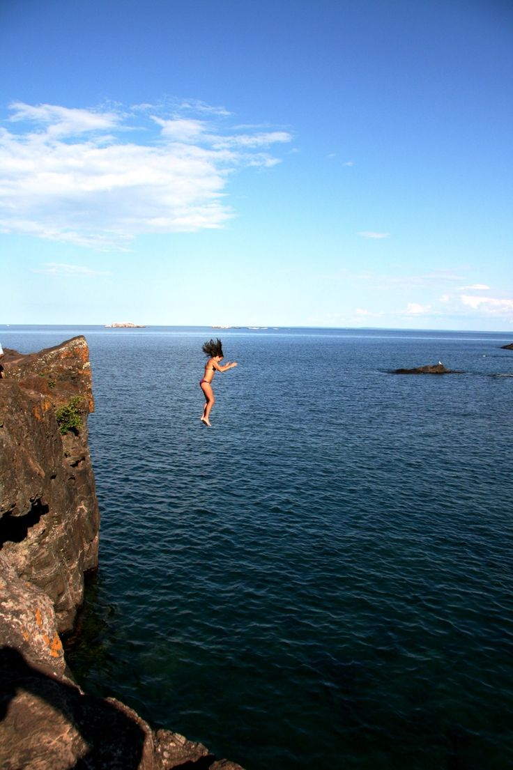 Cliff jumping from Blackrocks in Marquette, MI (Upper Peninsula). One of the best things to do in Marquette if you're a little adventurous! Read all about it here! http://www.thingstodointheup.com/black-rocks-marquette/