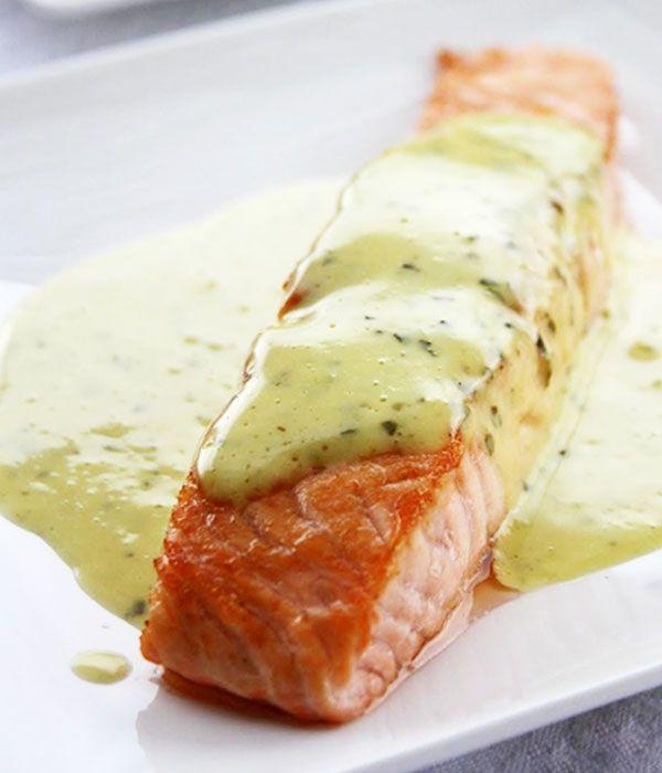 4 salmon fillets 1 oz (25g) fresh basil leaves 1 oz (25g) of mint leaves 7 oz (200ml) olive oil 1 egg yolk 1 teaspoon mustard 2 tablespoons cream Finely grated zest and juice of one lemon Oil Salt Ground pepper