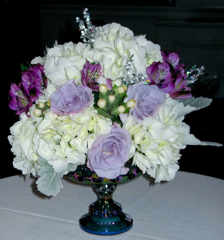White hydrangea centerpiece with purple alstromeria lavender