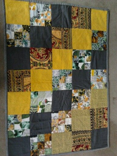 a quilt I made using vintage fabrics- candlewick, batik, and 50's dresses (photo only)