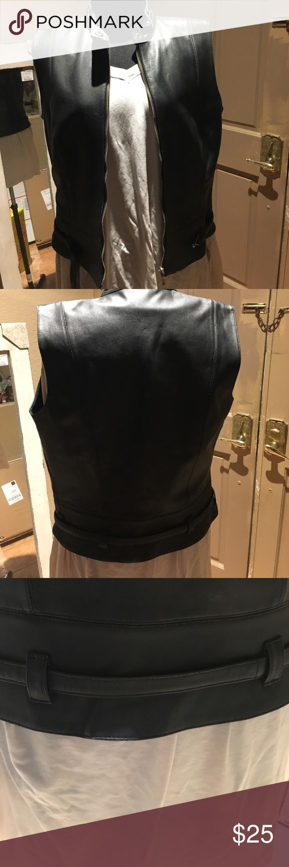 Cabi size Small Motorcycle Leather Vest This vest is made of black leather with a satin lining. Zippers up the front with a cool hook strap around the front. Bust measures about 36 inches, length about 21 1/2 inches. In excellent condition CAbi Jackets & Coats Vests