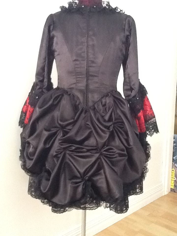 Goth/Rococo/Lolita dress finished in December 2013 and won to The Bastion Gothic Yule party. The bodice was patterned from a commercial pattern and the rest was ad libed as I went. There must be at least 25-30 meters of lace used on the dress and underskirt.