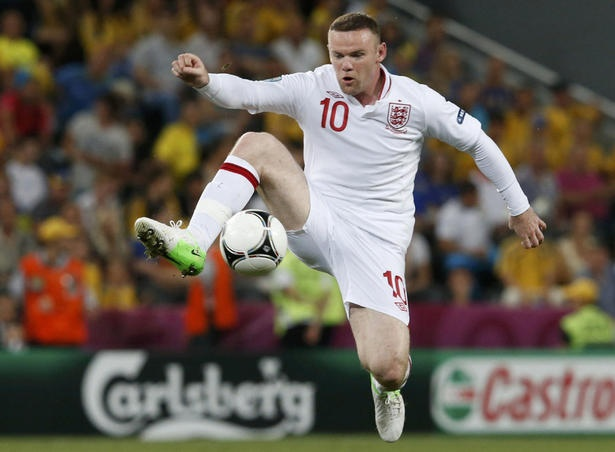 England's Wayne Rooney controls the ball during their Group D Euro 2012 soccer match against Ukraine at the Donbass Arena in Donetsk on Tuesday.