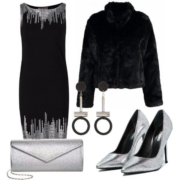 Outfit per una serata in giro a festeggiare: vestito nero con dettagli argentati smanicato, ecopelliccia nera, décolleté argentate, pochette argentata e orecchini lunghi dal disegno geometrico.