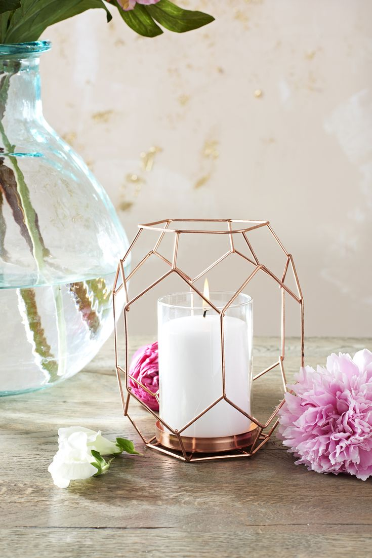 Pair copper geometric lanterns together with bright floral arrangements for a playful and contemporary centrepiece. Perfect for a fun-filled summer wedding.
