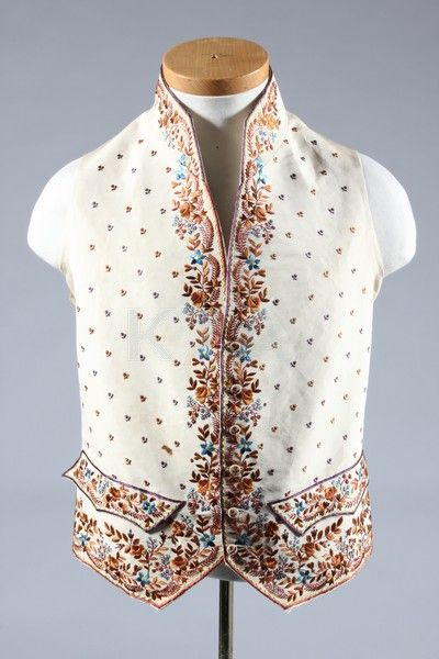 An embroidered gentleman's court waistcoat, first half 19th century in traditional 18th century style, embroidered with brown and blue silks with sprigged ground,