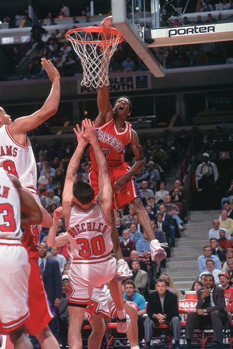 Allen Iverson dunks on Jud Buechler during a 1997 Bulls-Sixers game