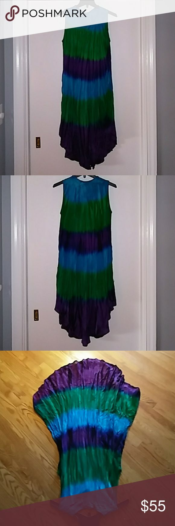 Gorgeous Tie Die Dress Beautiful tie die Bo.Ho sundress... I bought at local boutique.. 100% Viscose.. Longest part from shoulder is 40 inches.. 17 bust.. Without strech... Xxoo.. Does not have lining underneath.. Not very see through though. No size. One size fits most. Never worn. Boutique 9 Dresses