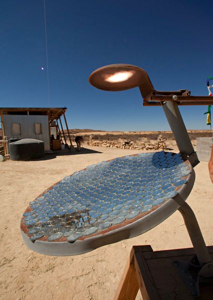 "Solar ""fryer"" made from an old satellite dish.    More about being off the grid in West Texas: http://www.nytimes.com/interactive/2011/03/10/garden/20110310-TEXAS-SLIDESHOW.html?ref=garden&_r=1"