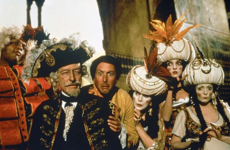 Eric Idle, Winston Dennis, and John Neville in The Adventures of Baron Munchausen (1988)