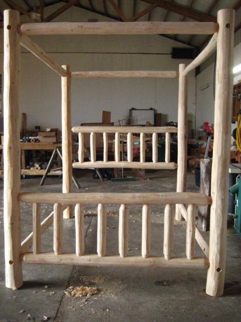 Best 25 log bed ideas on pinterest log bed frame for Log canopy bed frames