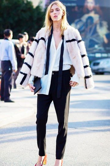 White Faux Fur Coat With Black Stripes As Part Of Androgynous Outfit #monochrome #fauxfurcoat #furcoat #blackandwhitecoat #monochromecoat #tailored #androgynous #taperedtrousers #whiteshirt #thinscarf #skinnyscarf #tiescarf #masculine #cocktailsuit #blacktie #quirky #fashionable #statement