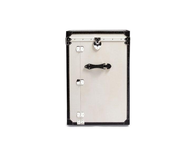 Nomad Trunk is a bespoke luggage designed by Hangar Design Group for Bertoni.  Outside: parchment leather with black alligator studded trim.  Interior: polished oak and black alligator trims and details.
