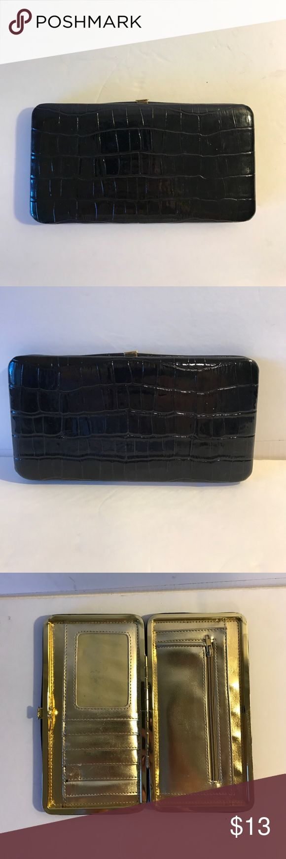 Super cute black patent leather wallet! Black patent leather wallet with gold metallic inside! Very cute!!! 7 inches long width is 3 3/4. Bags Wallets