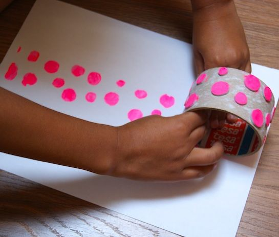 use an empty masking tape roll and stick selected designs all around, ink and roll the stamps for a creative border