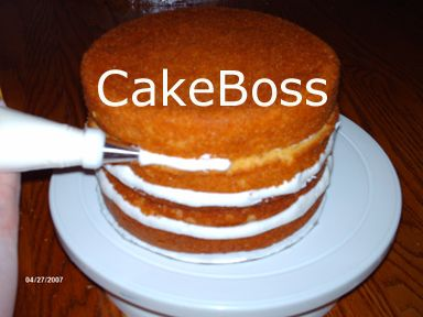 How to Prevent the cake from Bulging... I never assemble a cake without building an icing dam and filling in the sides with piped icing to prevent that dreaded side bulge...