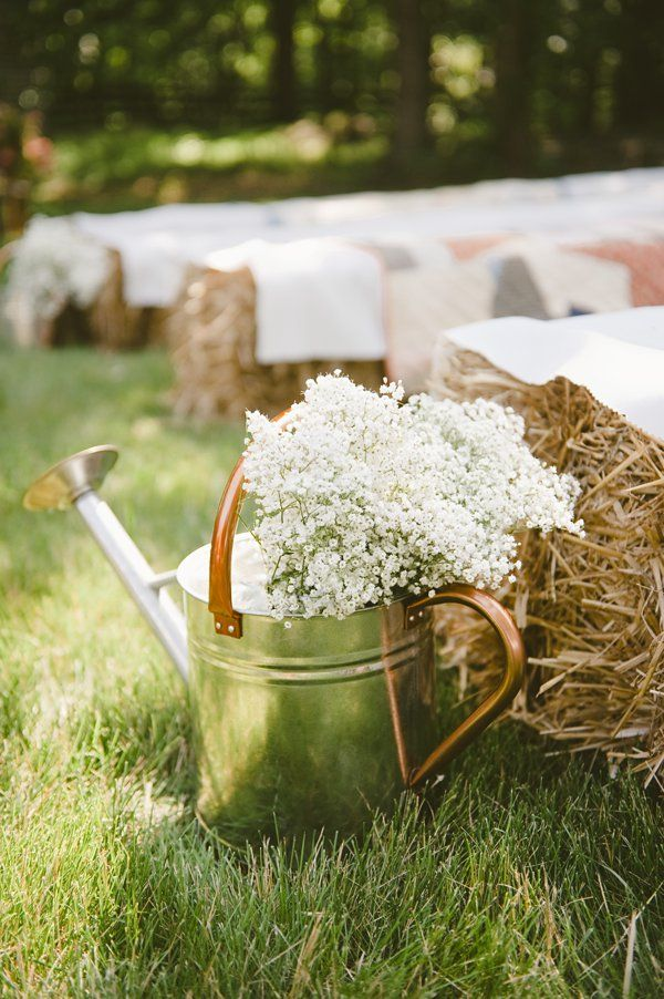 water-can with baby's breath makes for the perfect rustic aisle runner. http://www.weddingchicks.com/2013/10/21/beauteous-backyard-wedding/