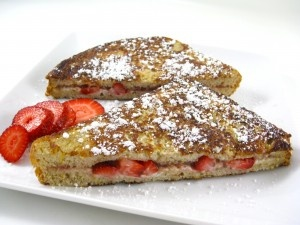 Skinny Strawberries & Cream Stuffed French Toast, made with whole wheat bread, egg whites, fat free cream cheese & fresh strawberries. YUM!