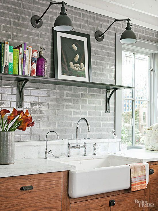 Thoughtful finishing touches, including vintage-look swing-arm sconces, antique pulls, and an elegant high-arcing faucet, contribute a rustic-refined vibe. The eclectic mix of accessories keeps the industrial look from feeling too trendy.