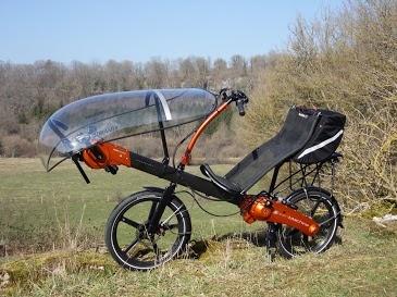 Flevo recumbent bike w/ wind guard/ rain-shield. Electric assist...