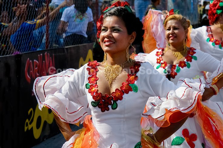 Colombian women dance Cumbia during the Carnival in Barranquilla, Colombia, 27 February 2006. The Carnival of Barranquilla is a unique festivity which takes place every year during February or March on the Caribbean coast of Colombia. A colourful mixture of the ancient African tribal dances and the Spanish music influence - cumbia, porro, mapale, puya, congo among others - hit for five days nearly all central streets of Barranquilla. Those traditions kept for centuries by Black African…