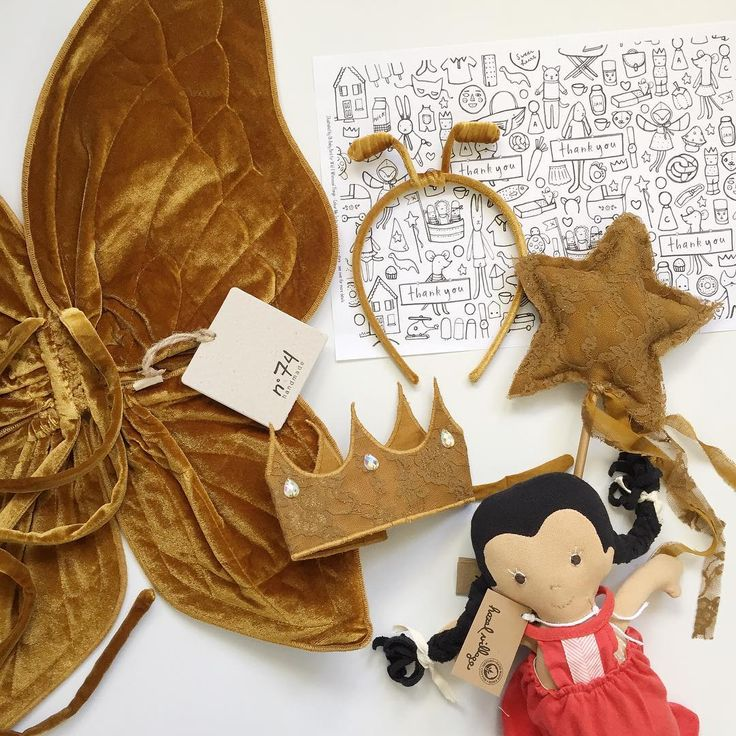 It is currently looking like perfect butterfly fluttering weather outside... Numero74 velvet gold Butterfly Wings, gold mat lace Carolina Crown and Star Wand #numero74 #kidscostumes #costumeaccessories