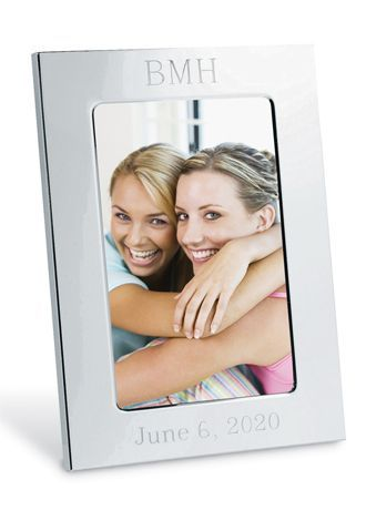 """A classic bridesmaid gift, our Personalized Silver Picture Frame is the perfect token of appreciation for everything your bridesmaid has done. Add a photo that captures your favorite moment together and give her a heartfelt keepsake to show just how much her friendship means to you. The frame features a stunning silver plated finish and makes a great gift that she will truly cherish for many years.  Features and Facts:  Measures: 5.5"""" W x 7.5"""" H. Holds 4 x 6 photo."""