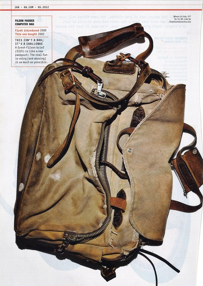 Vintage Filson bag in GQ >>>  I love this page layout, and how the product's best feature (extreme durability) is presented, imperfect, stained, frayed but intact. Most product layouts show the merch in its most perfect condition, which can get boring.