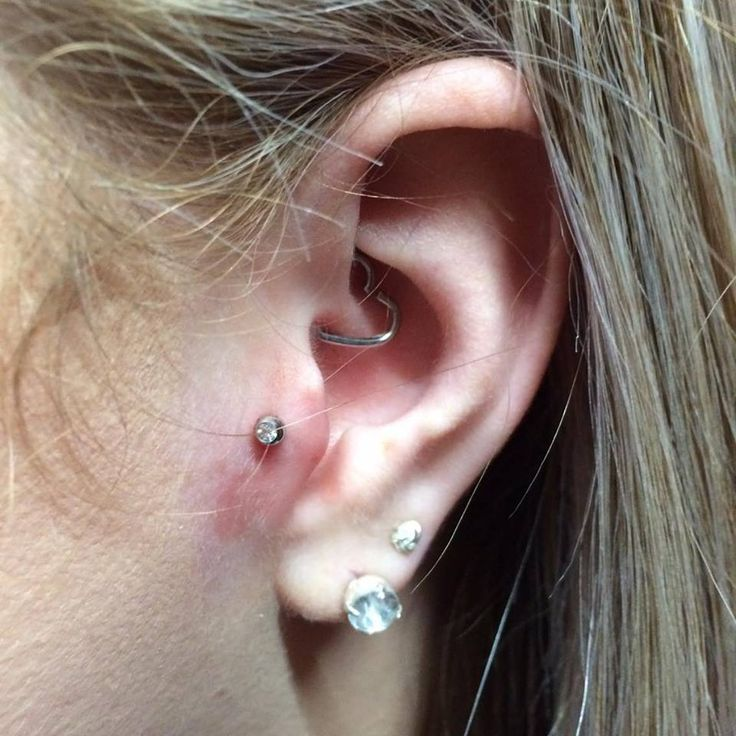 Fresh tragus piercing with a gem stud labret - by Sophie