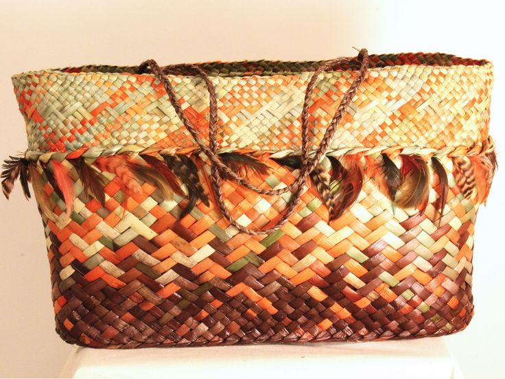 Kete: Beautiful feather trimmed kete in autumn colors.