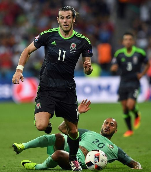 Portugal 2 Wales 0 in July 2016 in Lyon. Gareth Bale steams forward leaving Quaresma grounded in the Semi Final of Euro 2016.