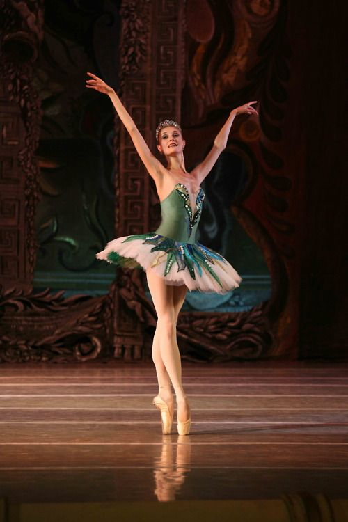 She smiles as she's dancing pointe. I wonder how much painful nights she, her feet, had to suffer through for her to achieve her perfect poise.