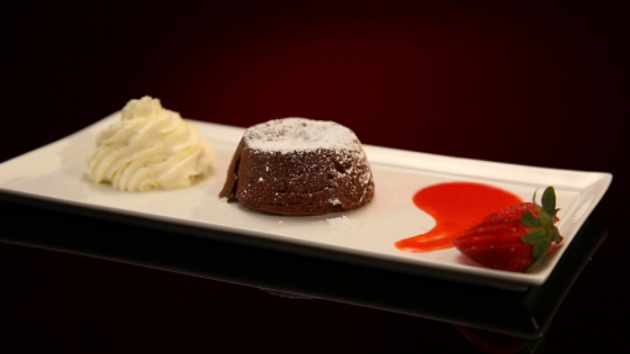 Chocolate volcano cake with strawberry coulis