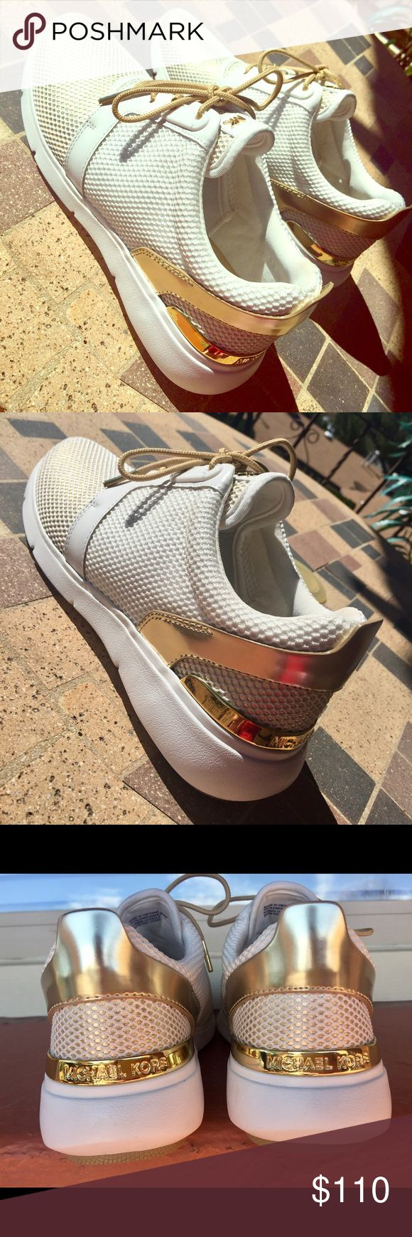 Michael Kors white and gold shoes Size 8 women's. Brand new. Worn only once, in perfect condition. Michael Kors Shoes Sneakers