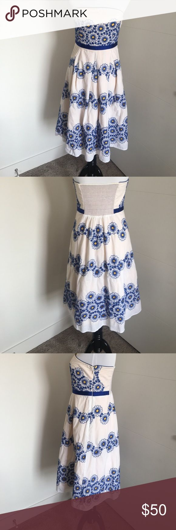 FLASH SALE!! White Anthropologie dress sz 6 Strapless white dress with blue embroidered flowers and yellows underlay. Has blue ribbon at waist. Hidden zipper on side. Has elastic panel in back for perfect fit. Hits at calf. Tulle at bottom makes a subtle, full skirt. Amazing dress for nights out or for more formal gatherings. Would look fantastic over a crisp white button down for colder weather. Anthropologie Dresses Strapless