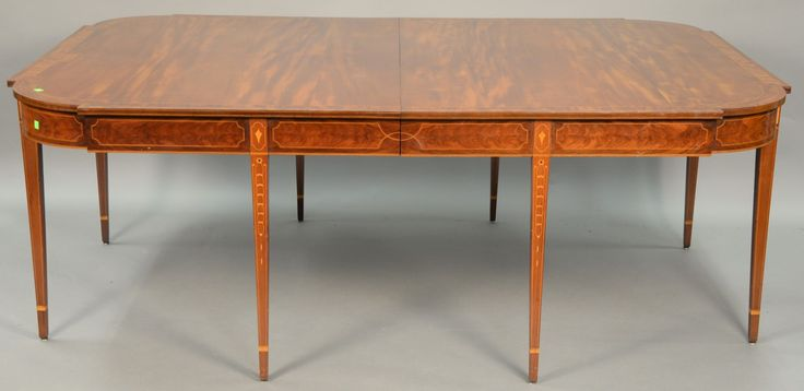 Margolis mahogany dining table having banded inlaid top with D shaped ends on conforming frieze, all on bookend panel and ring inlaid square tapered legs and center drop down legs. Realized Price $6,600.00