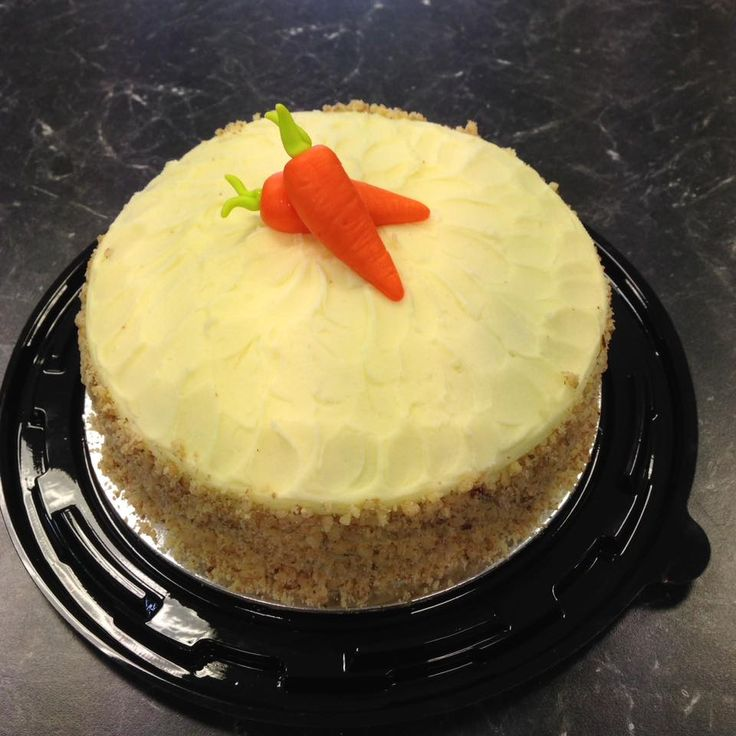 Carrot Cake with Cream Cheese Frosting and Crushed Walnuts decorated by Coast Cakes Ltd
