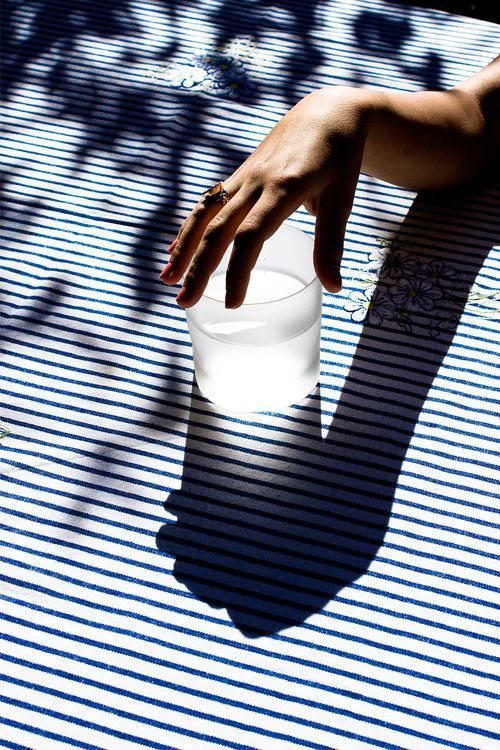 hand on a glass of water, stripes
