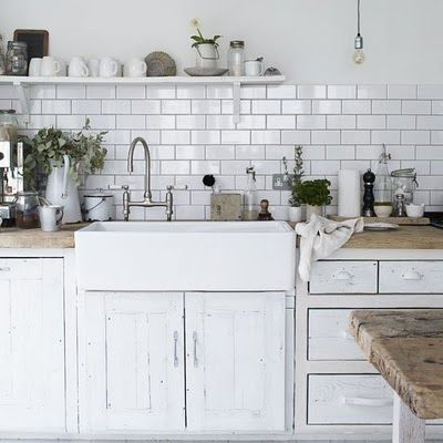 This white tile/gray grout with some butcher block countertop would be so pretty. maybe a mix of countertops?