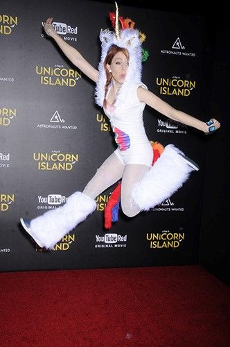 Lindsey Stirling jumps on the red carpet of A Trip to Unicorn Island at TCL Chinese Theatres.