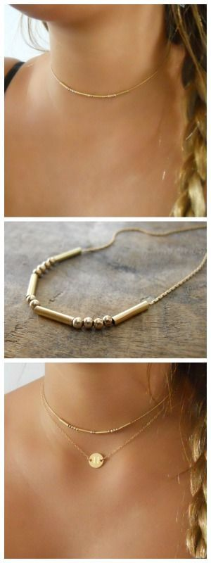 Dainty gold necklace with gold beads.