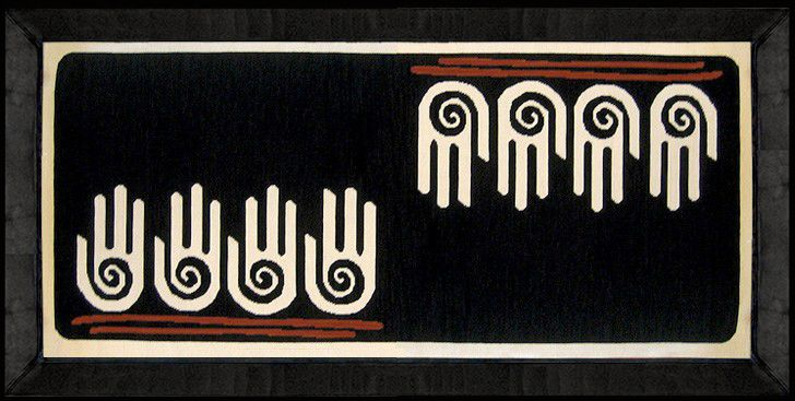 OCHO MANOS (RUG) This hand woven rug in arpillera with leather borders (10 cm.) was inspired by Pre-Colombian stamps. Made by www.gogoanhalzer.com
