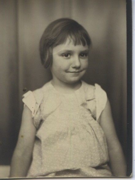 Vintage photo booth portrait. ASSURED LITTLE GIRL.