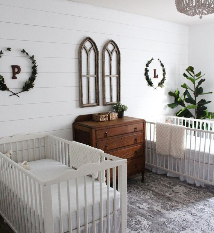 Oh my, what a beautiful nursery for twin babies. I love the vintage style and the colors. The two arched windows frames with the antique desk are what make this room so unique.