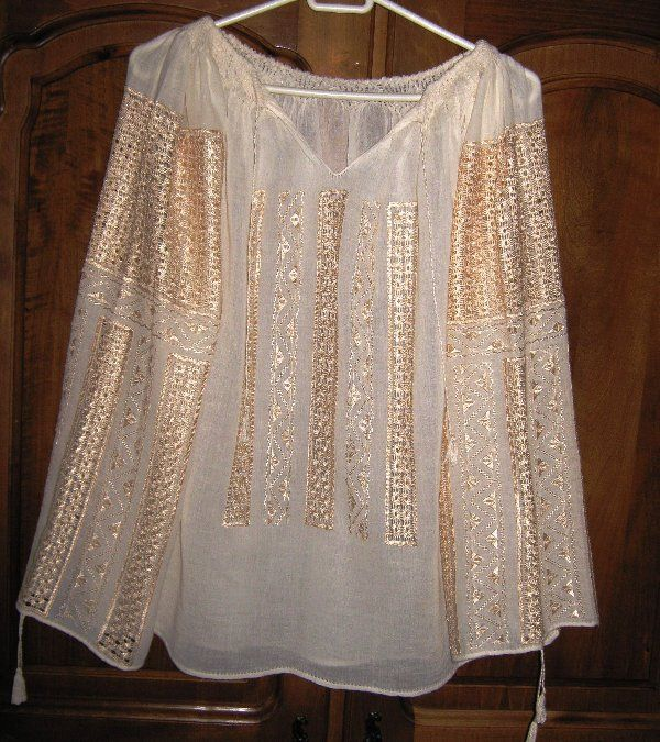 Great for for going out or a summer party. Great with a pair of shorter white pants and a cute pair of sandal shoes.  akt   Traditional Romanian peasant blouse