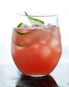 5 cups cubed seedless watermelon (about 1 1/2 pounds)   1 large English cucumber, peeled and cut into chunks   1/4 cup fresh lime juice (from 2 limes)   2 tablespoons honey   2/3 cup vodka   Ice   Cucumber slices, for garnish