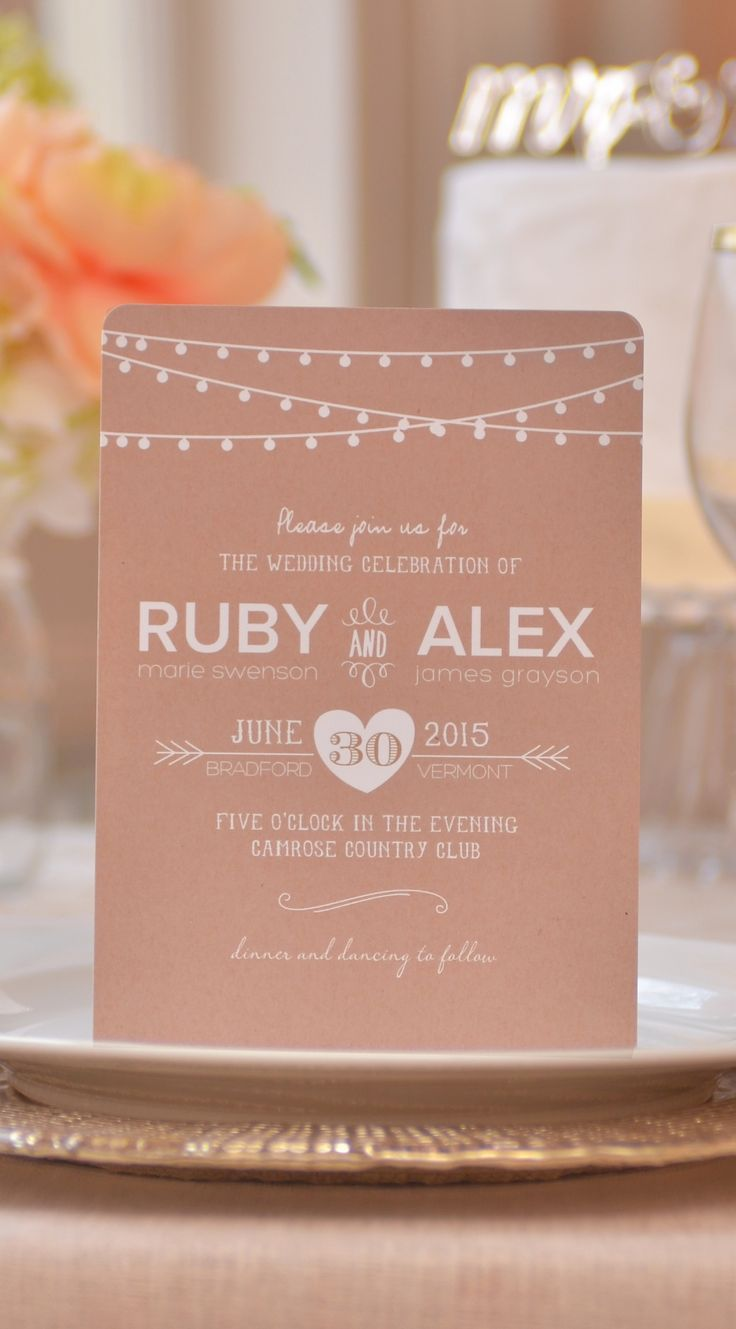 A modern wedding invitation with hanging light