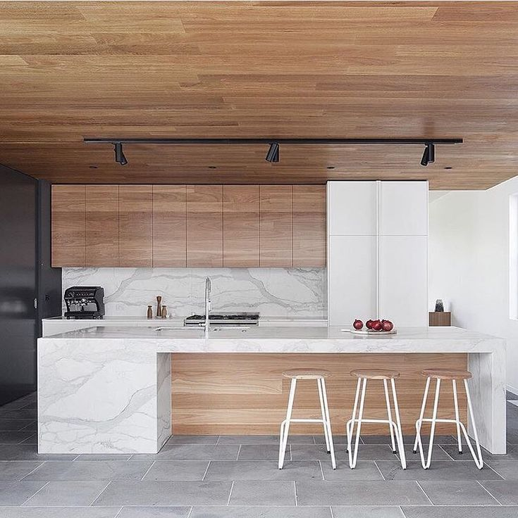 Gorgeous #interiors in this #kitchen designed by @bowerarchitecture using Australian bluestone blackbutt wood and a #kitchenisland made from calacatta marble.  Photo by @shannonmcgrath7 by designmilk